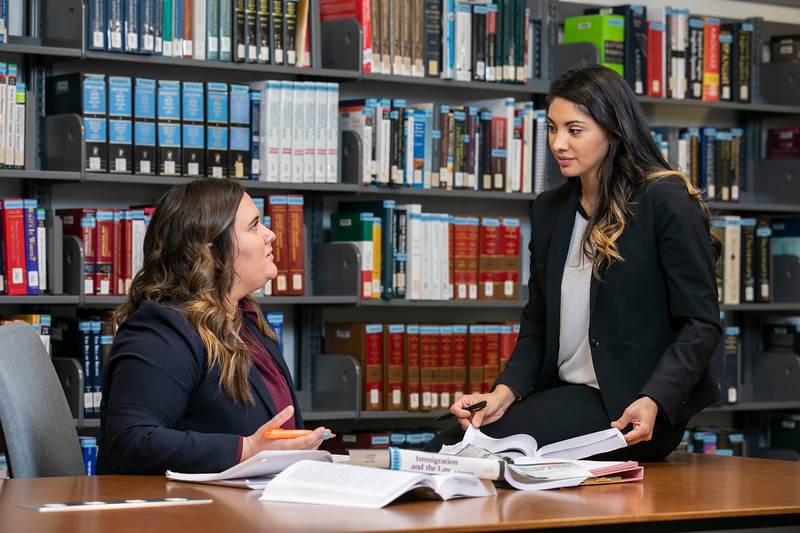 Law students Emily Ahdieh and Samanta Martinez-Villarreal study in preparation to defend their client, who was being detained in an immigration detention center. The students participating in the new Immigration Litigation Clinic successfully got their client out on bond.  Photo by:  Ron Aira/Creative Services