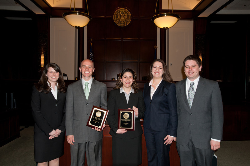 """(L to R) Law School students  Kristen Kugel, Chief Justice, """"defendant"""" Timothy Cronin, """"plaintiff"""" Azadeh Malek, Catherine Brown, Vice Justice, and Matthew Perushek, Managing Justice pose after they competed in the Law School's final round of the First Year Moot Court Competition at US District Court, Eastern District of Virginia, in Alexandria. Photo by Alexis Glenn/Creative Services/George Mason University"""