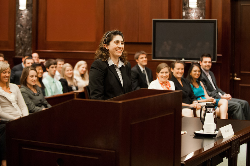 """Law School student and """"plaintiff"""" Azadeh Malek smiles after she won her case at the Law School's final round of the First Year Moot Court Competition at US District Court, Eastern District of Virginia, in Alexandria. Photo by Alexis Glenn/Creative Services/George Mason University"""