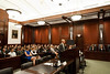 "Law School students listen as student and ""defendant"" Timothy Cronin presents his case at the Law School's final round of the First Year Moot Court Competition at US District Court, Eastern District of Virginia, in Alexandria. Photo by Alexis Glenn/Creative Services/George Mason University"
