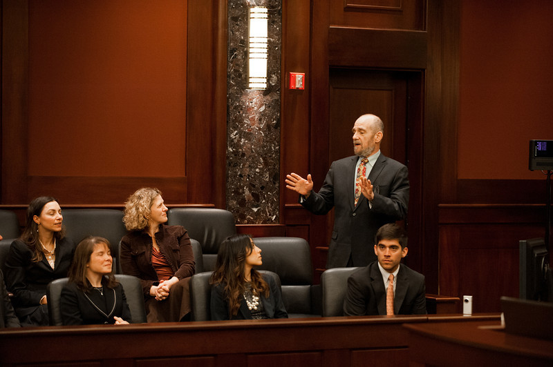Law School Dean Daniel Polsby (R) speaks at the Law School's final round of the First Year Moot Court Competition at US District Court, Eastern District of Virginia, in Alexandria. Photo by Alexis Glenn/Creative Services/George Mason University