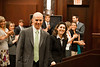 "Law School students applaud ""defendant"" Timothy Cronin and ""plaintiff"" Azadeh Malek at the Law School's final round of the First Year Moot Court Competition at US District Court, Eastern District of Virginia, in Alexandria. Photo by Alexis Glenn/Creative Services/George Mason University"