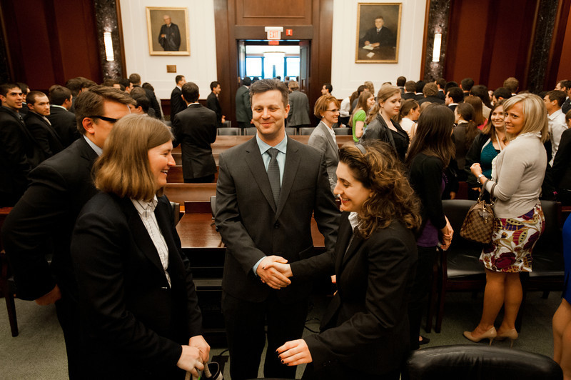 """Law School student and """"plaintiff"""" Azadeh Malek greets friends after she competed in the Law School's final round of the First Year Moot Court Competition at US District Court, Eastern District of Virginia, in Alexandria. Photo by Alexis Glenn/Creative Services/George Mason University"""