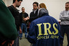 Students, from the Accounting Honors Program, pose as honorary agents during a mock investigation performed by the IRS.  Photo by Craig Bisacre/Creative Services/George Mason University