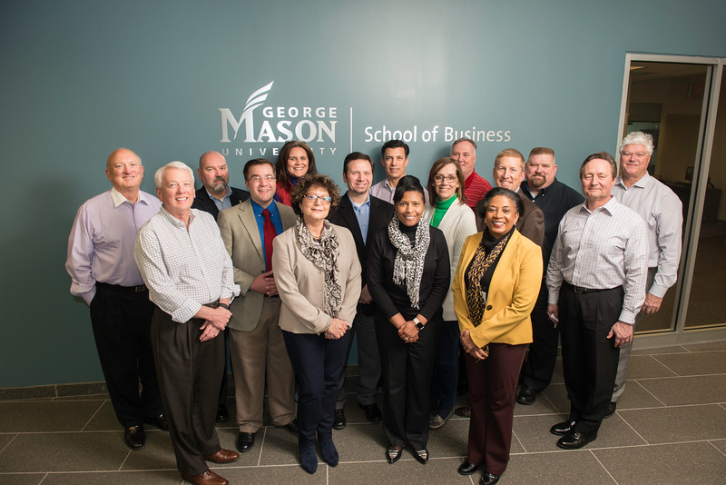 Students from the Executive Chief Learning Officer Certificate Program, through the School of Business, pose in Founders Hall on Arlington Campus.  Photo by Ron Aira/Creative Services/George Mason University