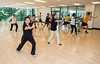 Professor Xiaolin Lu leads a Tai Chi class at the Recreational/Athletic Complex (RAC) at Fairfax Campus. Photo by Alexis Glenn/Creative Services/George Mason University