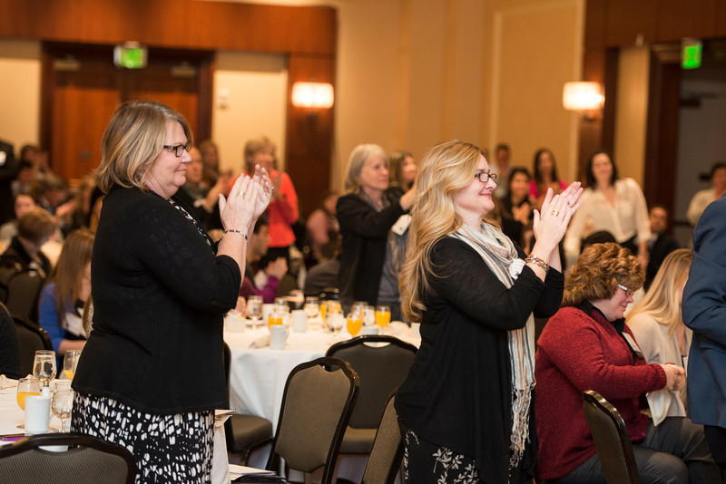 Attendees give a standing ovation to Claire Bible, graduate of the Cutting Edge Program at Edgewood College, after she spoke at the State of the Art conference at the Mason Inn. Photo by Alexis Glenn/Creative Services/George Mason University