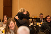 Claire Bible, graduate of the Cutting Edge Program at Edgewood College, hugs an attendee after she spoke at the State of the Art conference at the Mason Inn. Photo by Alexis Glenn/Creative Services/George Mason University