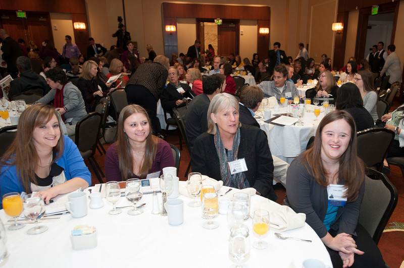 Keynote speaker Claire Bible (R), graduate of the Cutting Edge Program at Edgewood College, sits with other attendees at the State of the Art conference at the Mason Inn. Photo by Alexis Glenn/Creative Services/George Mason University
