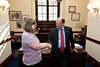 Mason LIFE student Sarah Meade shakes hands with Delaware Senator Chris Coons in his Congressional office on Capitol Hill in Washington DC.
