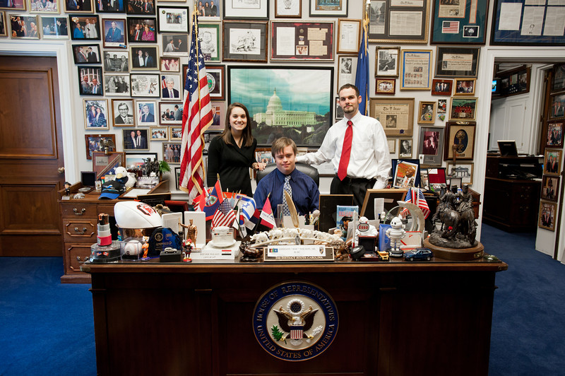 Mason LIFE student Adrian Forsythe sits at the desk of South Carolina Representative Joe Wilson in his Congressional office on Capitol Hill in Washington DC. With Adrian are Staff Assistant Lora Hobbs and Mason Graduate student Andrew Shaw.