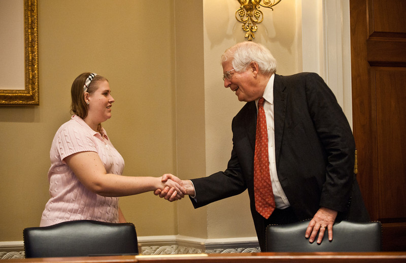 North Carolina Rep. David Price (R) greets a Mason LIFE Student in a hearing room of the Longworth House Office building on Capitol Hill in Washington DC.