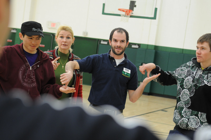 Mason faculty in the the College of Education and reps from the State Department work with youth as a part of the Sports United grant.  Photo by Creative Services/George Mason University