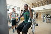 Students in a PHED 108: Weight Training and Body Conditioning class use the machines at the RAC at Fairfax campus. Photo by Alexis Glenn/Creative Services/George Mason University