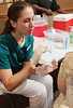 090915004e - CHHS nursing students giving flu shots. Photo by Creative Services/George Mason University
