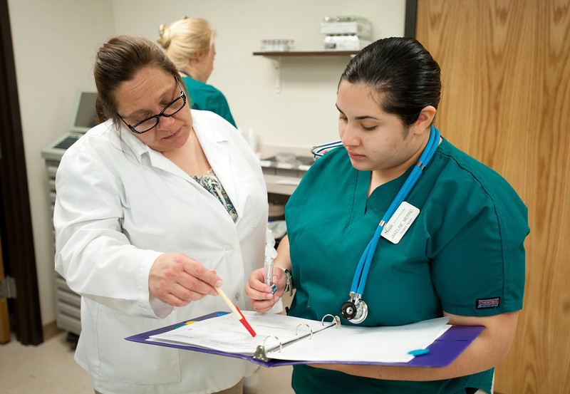 CHHS Nursing student Jakeline Merino (R) and Professor Mary Lou Davis work in the Simulation Lab, as  supervises at Fairfax Campus. Photo by Alexis Glenn/Creative Services/George Mason University