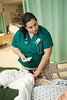 CHHS Nursing student Jakeline Merino works in the Simulation Lab at Fairfax Campus. Photo by Alexis Glenn/Creative Services/George Mason University