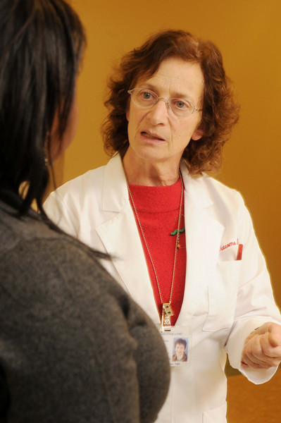 090113156e - Director of CHHS's Center for Chronic Illness and DIsability, Lynn Gerber, speaks with a patient in the Functional Assessment Laboratory at Inova Fairfax Hospital.