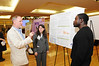 Left to right: Len Nichols, Director, Health Policy Research & Ethics Center; and Mason student Elizabeth Isaacs Flashner, MS, present and discuss Health Reform Options for Fairfax County research poster at the CHHS Research Day. Photo by Evan Cantwell/Creative Services/George Mason University