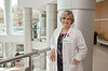 Middle, 120329504, Prof. Beverly Middle, RN, MSN, School of Nursing, CHHS, and PhD student, shadows Dierdre Carolan on her daily rounds at Inova Hospital in Fairfax. Photo by Alexis Glenn/Creative Services/George Mason University