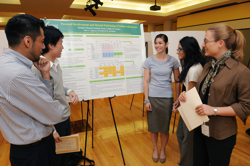 Associate Professor Kathryn Jacobsen working with students on College of Health and Human Services Research Day. Photo by Evan Cantwell/Creative Services/George Mason University