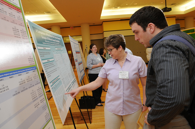 Associate Professor Lisa Lindley, Global and Community Health, presents and compares risk factors between groups of different sexual orientations at CHHS Research Day. Photo by Evan Cantwell/Creative Services/George Mason University