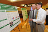 Left to right: Dr. Randall Keyser, Associate Professor of Rehabilitation Science, and Mason student Josh Woolstenhulme, present research on the effects of aerobic exercise on cardiorespiratory function in patients with interstitial lung disease at CHHS Research Day. Photo by Evan Cantwell/Creative Services/George Mason University