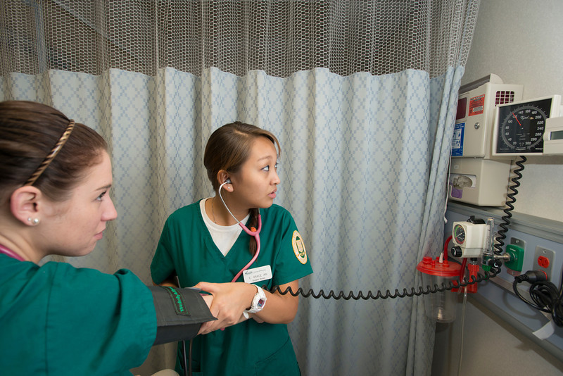 CHHS Nursing student Grace An works in the Nursing Lab at Fairfax campus. Photo by Alexis Glenn/Creative Services/George Mason University