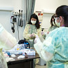 High school students practice nursing techniques through hands on activities at Nursing Camp. (Bethany Camp/Creative Services/George Mason University)