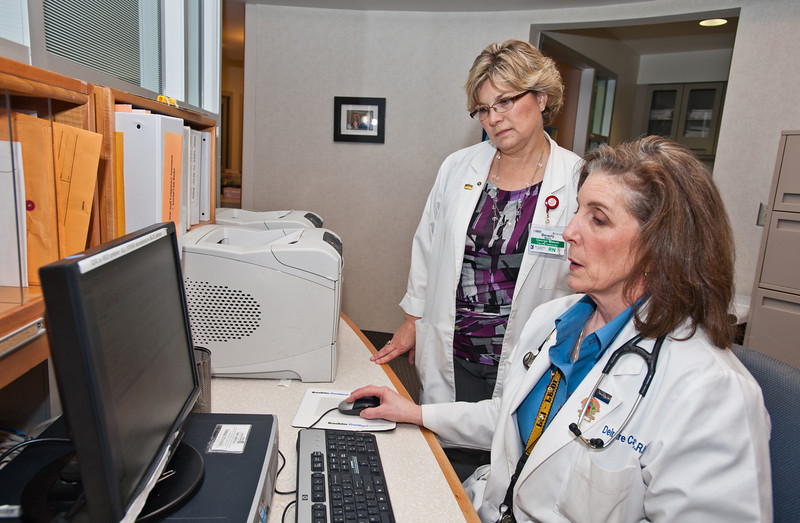 Prof. Beverly Middle (L), RN, MSN, School of Nursing, CHHS, and PhD student, shadows Dierdre Carolan on her daily rounds at Inova Hospital in Fairfax. Photo by Alexis Glenn/Creative Services/George Mason University