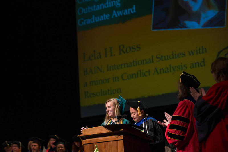 Lela Ross accepts an outstanding graduate award at the New Century College Convocation. Photo by Evan Cantwell/Creative Services/George Mason University