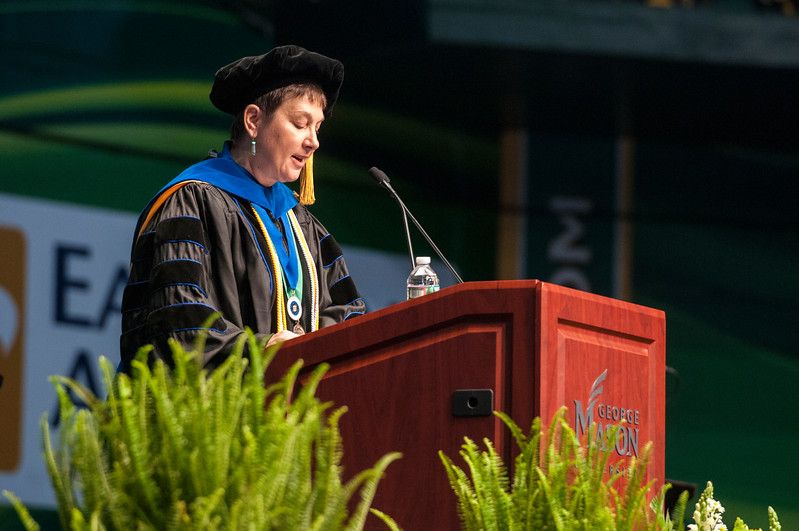Dean Deborah A. Boehm-Davis addresses graduates, friends, and family during the College of Humanities and Social Sciences I Degree Celebration.  Photo by Bethany Camp/Creative Services/George Mason University