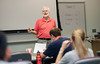 Professor Andrew Finn teaches COMM 100, Public Speaking, at Fairfax Campus. Photo by Alexis Glenn/Creative Services/George Mason University