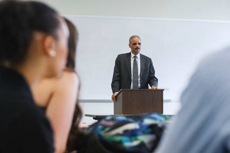 U.S. Attorney General Eric Holder speaks during Laurie Robinson class in University Hall. Photo by Craig Bisacre/Creative Services/George Mason University