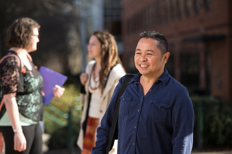Professor Al Fuertes in the North Plaza.  Photo by Craig Bisacre/Creative Services/George Mason University