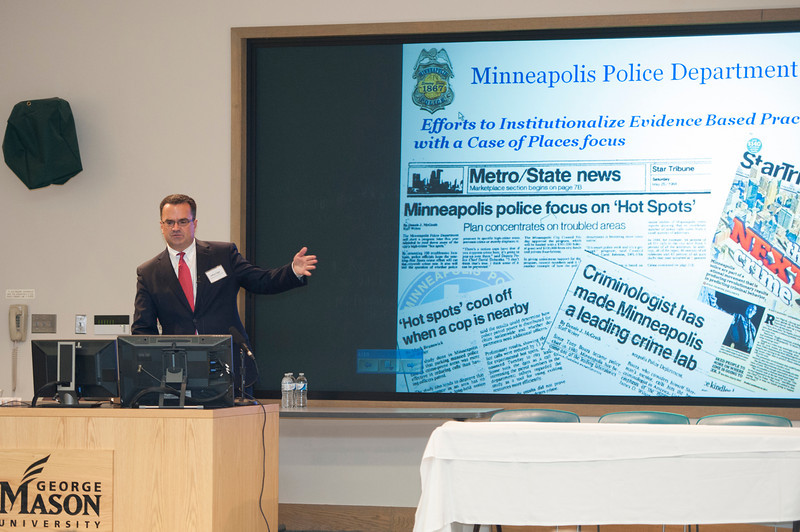 Sgt. Jeffery Egge, Minneapolis Police Department, presents research at the Center for Evidence-Base Crime Policy (CEBCP) symposium. Photo by Alexis Glenn/Creative Services/George Mason University