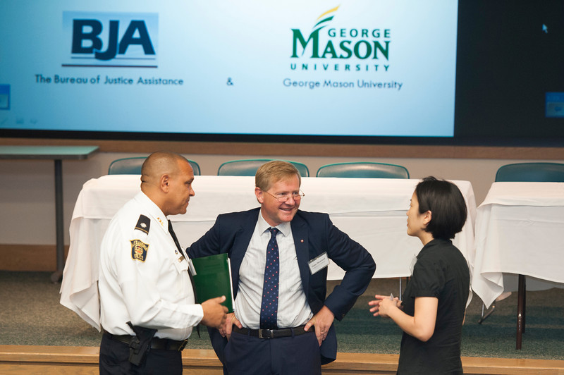 (L to R) Hassan Aden, Deputy Chief, City of Alexandria, Retired Chief Constable Peter Neyroud, and Cynthia Lum, co-Director of the Research Program on Evidence-Based Policing, attend the Center for Evidence-Base Crime Policy (CEBCP) symposium. Photo by Alexis Glenn/Creative Services/George Mason University