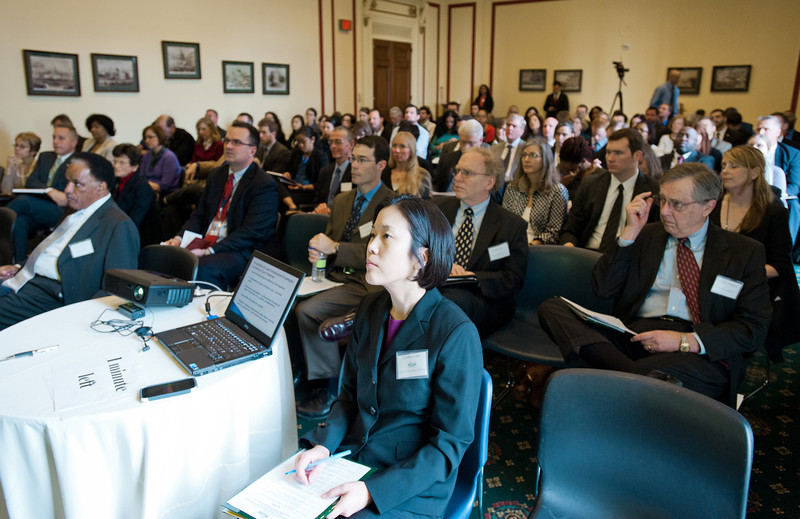 Deputy Director of the Center for Evidence-Based Crime Policy Cynthia Lum (C) and attendees listen to a presentation at the Center for Evidence-Based Crime Policy Symposium on Capitol Hill in Washington DC. Photo by Alexis Glenn/Creative Services/George Mason University