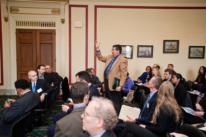 An attendee asks a question to a presenter at the Center for Evidence-Based Crime Policy Symposium on Capitol Hill in Washington DC. Photo by Alexis Glenn/Creative Services/George Mason University