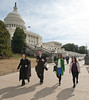 Deputy Director of the Center for Evidence-Based Crime Policy Cynthia Lum (L) walks with Criminology, Law and Society graduate students Cody Telep (2nd L), Ajima Olaghere, and Julie Grieco (R) as they depart the Center for Evidence-Based Crime Policy Symposium  on Capitol Hill in Washington DC. Photo by Alexis Glenn/Creative Services/George Mason University