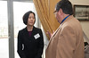 Deputy Director of the Center for Evidence-Based Crime Policy Cynthia Lum speaks with an attendee at the Center for Evidence-Based Crime Policy Symposium on Capitol Hill in Washington DC. Photo by Alexis Glenn/Creative Services/George Mason University