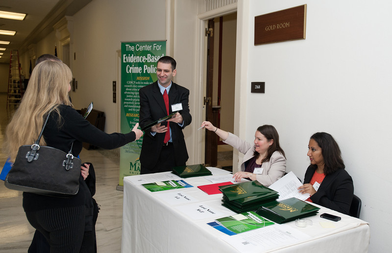 Criminology, Law and Society students (L to R) Cody Telep, Julie Grieco, and Jaspreet Chahal volunteer at the Center for Evidence-Based Crime Policy Symposium on Capitol Hill in Washington DC. Photo by Alexis Glenn/Creative Services/George Mason University