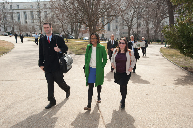Criminology, Law and Society graduate students (L to R) Cody Telep, Ajima Olaghere, and Julie Grieco depart the Center for Evidence-Based Crime Policy Symposium on Capitol Hill in Washington DC. Photo by Alexis Glenn/Creative Services/George Mason University