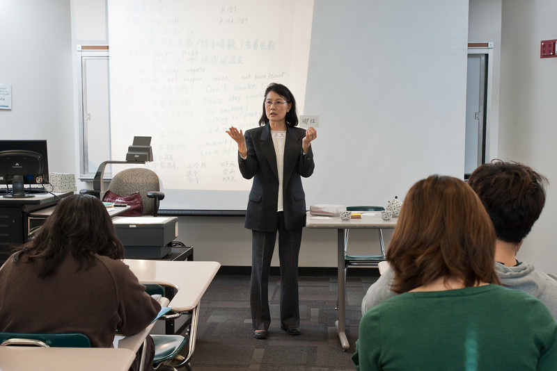 Professor Xu Wang teaches a language course, Elementary Chinese, at Enterprise Hall at Mason's Fairfax Campus.