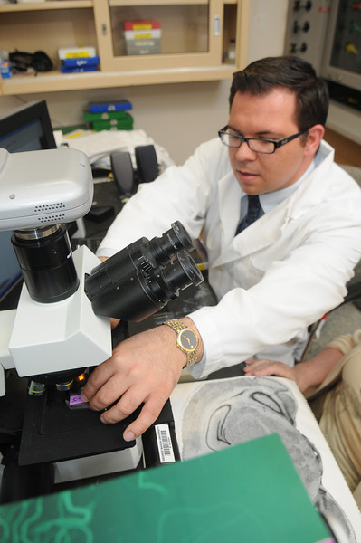 Dr. Jane Flinn and student, Chance Sizemore, at work in the lab.
