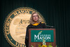 Christine H. Fox, Acting Deputy Secretary of Defense, BS Mathematics '76 and MS Applied Mathematics '80, congratulates graduates in her convocation speach during the College of Science Convocation. Photo by Evan Cantwell/Creative Services/George Mason University