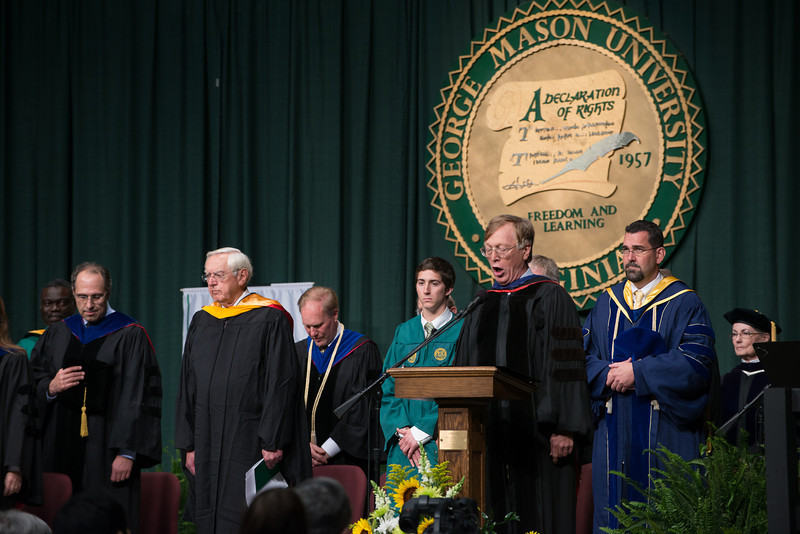 Professor, Department of Environmental Science and Policy, R. Christian Jones, recites the National Anthem during the College of Science Convocation. Photo by Evan Cantwell/Creative Services/George Mason University