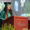Kinza Noor, who is receiving a Bachelor of Science in Biology, addresses the graduates during the College of Science Degree Celebration.  Photo by Bethany Camp/Creative Services/George Mason University