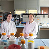 Current Princeton student Temple Douglas (on left), poses with her mentor Alessandra Luchini, Assistant Professor, Applied Proteomics & Molecular Medicine, in the Applied Proteomics & Molecular Medicine lab. Douglas interned with Luchini through the Aspiring Scientist Summer Internship Program.  Photo by Evan Cantwell/Creative Services/George Mason University.