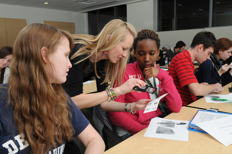 Jocelyn Prendergast, Assistant Professor teaching (left to right) Junior Jennifer Lewaine and Freshman Shaunteace Mazyck electrostatic lifting of fingerprint impressions in her Introduction to Criminalistics class.